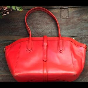 Jcrew orange leather bag with magnetic closure.